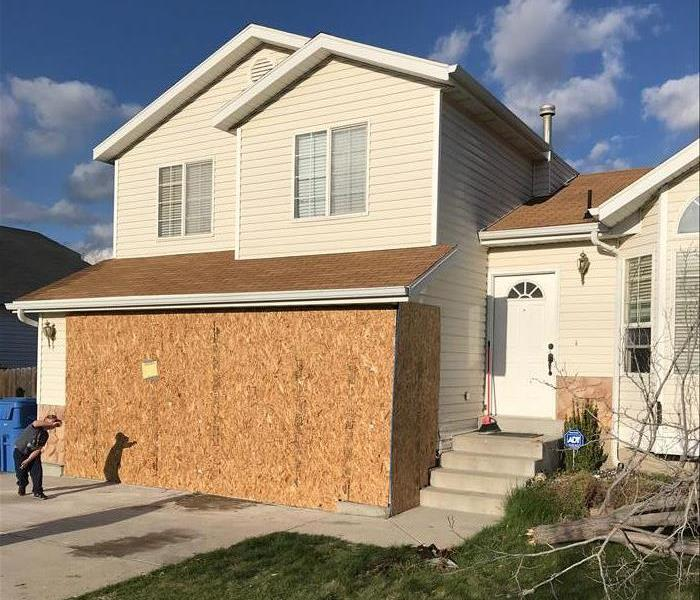 Board Up After Car Crashes Through Garage After