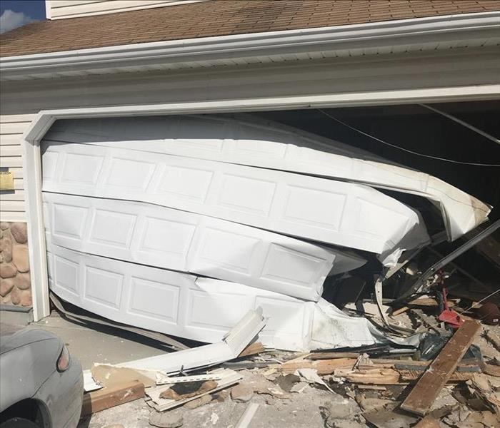 Board Up After Car Crashes Through Garage Before