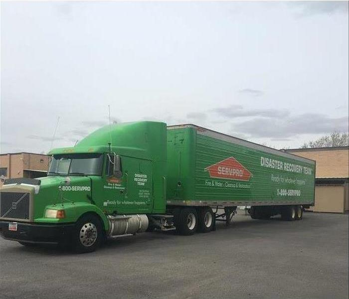 Picture of a green SERVPRO semi truck